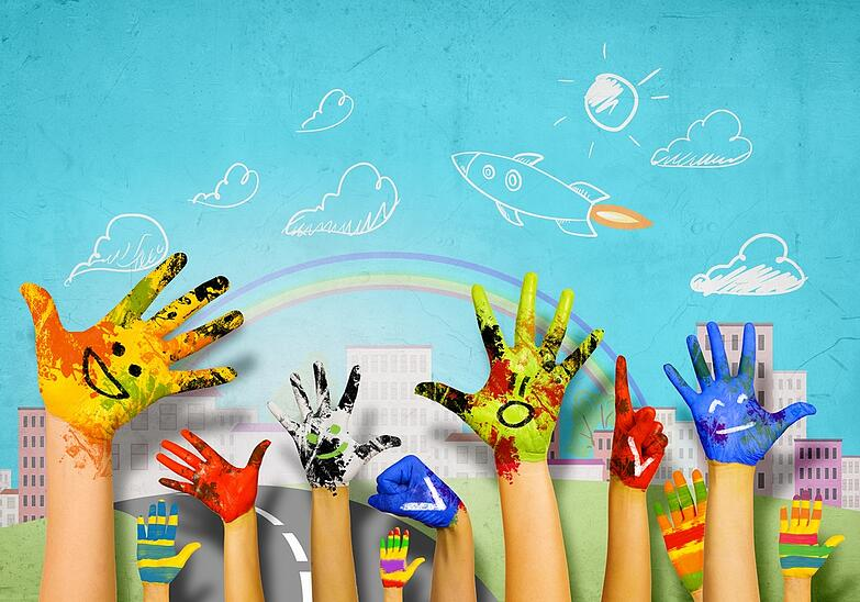 Human hands in colorful paint showing symbols.jpeg
