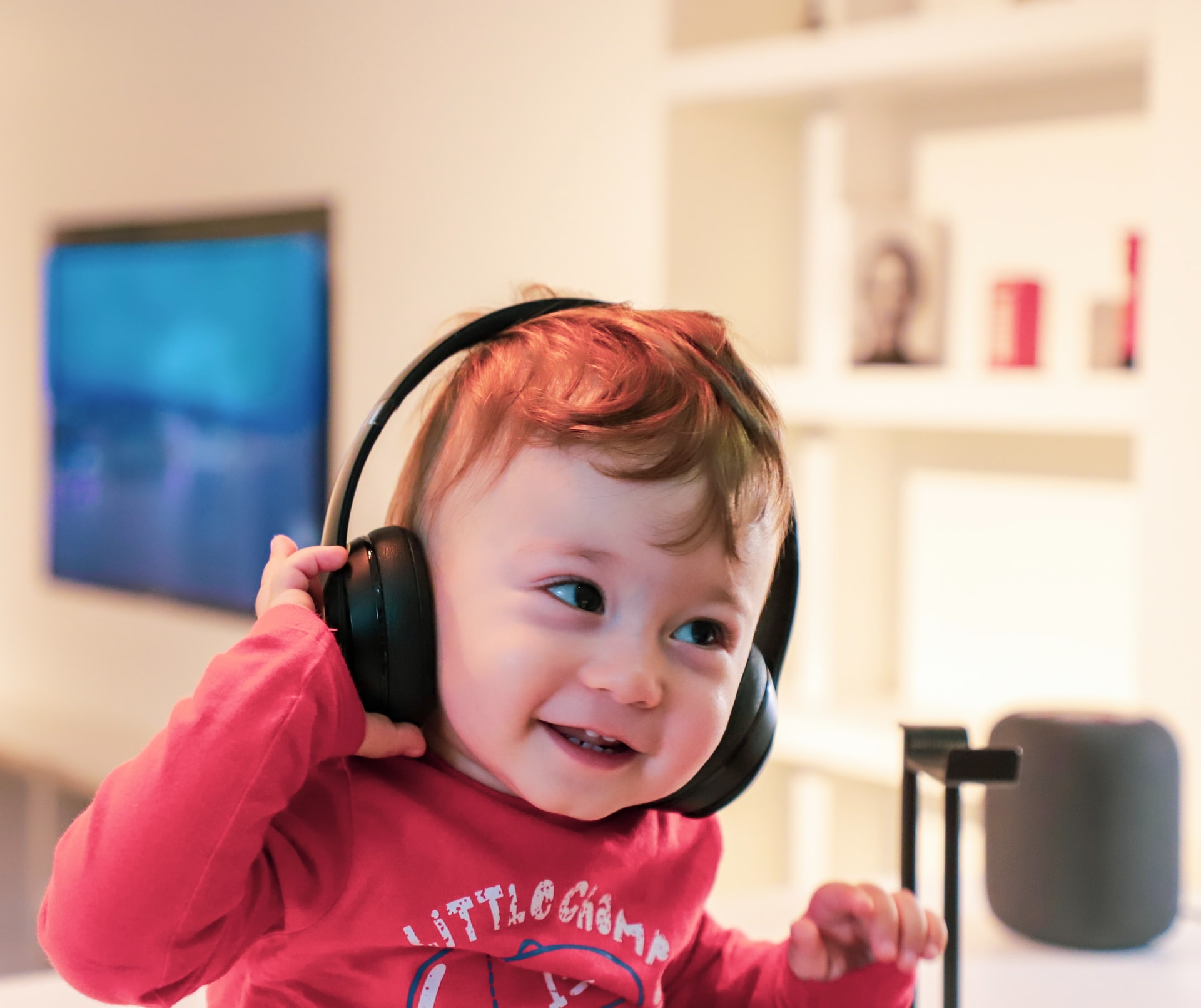 young child with autism wearing sensory headphones