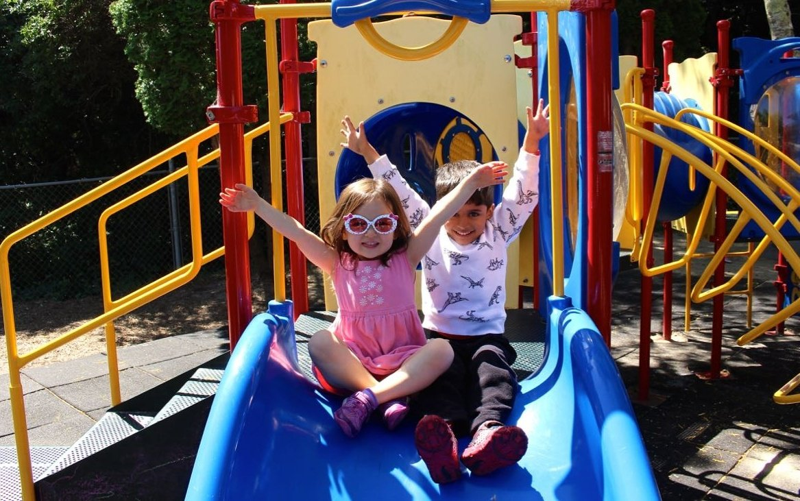 san_mateo_children_on_slide_arms_up-447870-edited.jpg