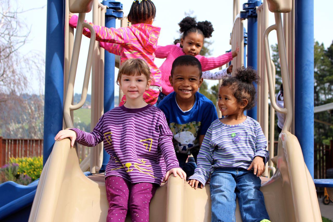 Oakland preschool kids on slide